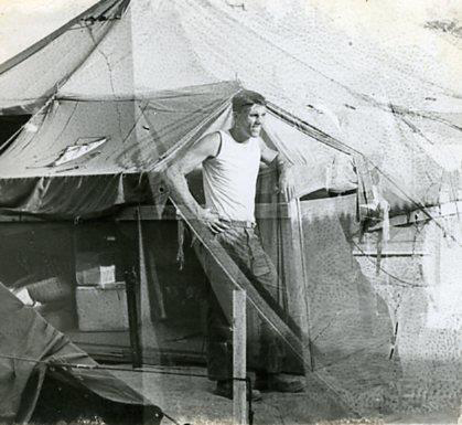 Sam outside his tent in Vietnam