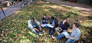 students_sitting_quad_fall_featured